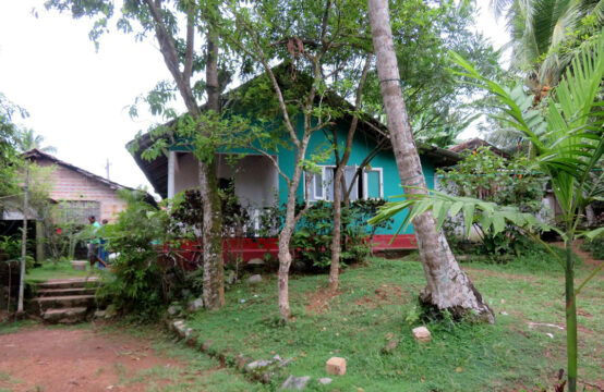Land with 2 houses for sale close to beach