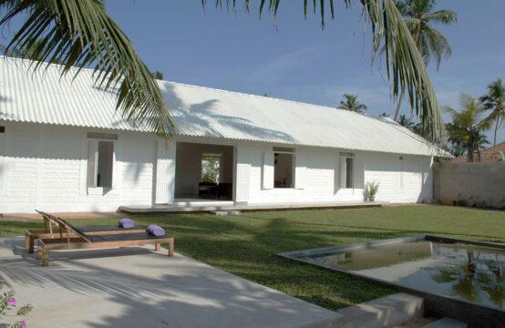 Elegant villa on quiet sandy beach for sale